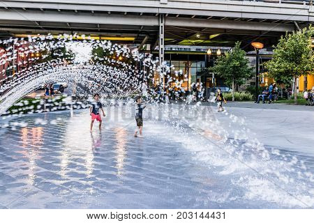 Washington Dc, Usa - August 4, 2017: Young Boys Children Playing In Water Fountain In Georgetown Par