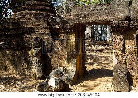 Wat Khao Suwankhiri temple and ancient statue in Sisatchanalai Historical Park Sukhothai province Thailand