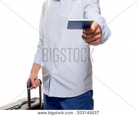 Happy young tourist with passport and valise at border control. part of man