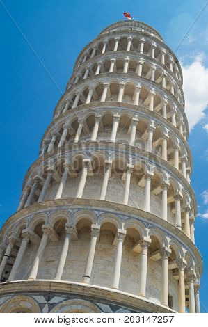 The Leaning Tower of Pisa against blue sky, Pisa, Italy.
