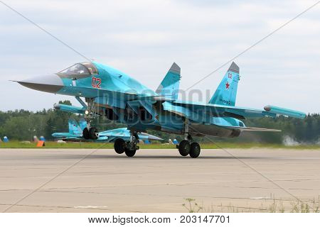 Kubinka, Moscow Region, Russia - June 20, 2015: Sukhoi Su-34 RF-95802 of russian air force taking off at Kubinka air force base.