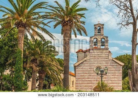 Church of Holy Trinity in Old Town, Budva, Montenegro.  Traditional stone church and paved square in Montenegro tourist capital.