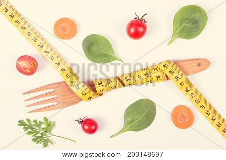 Vintage Photo, Wooden Fork Wrapped Tape Measure And Fresh Ripe Vegetables, Concept Of Slimming And H