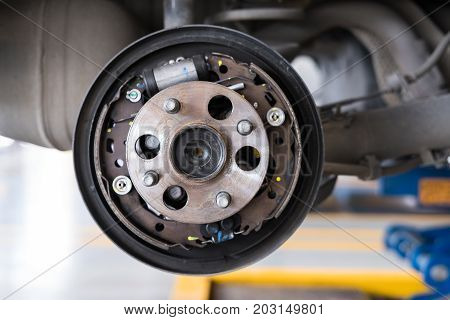 Car Suspension & Bearing Of Wheel Hub In Auto Service Maintenance. Car Lift Up By Hydraulic, Waiting