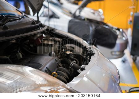 car in garage. vehicle maintenance in auto repair service shop. automobile annual checkup. fixing checking concept