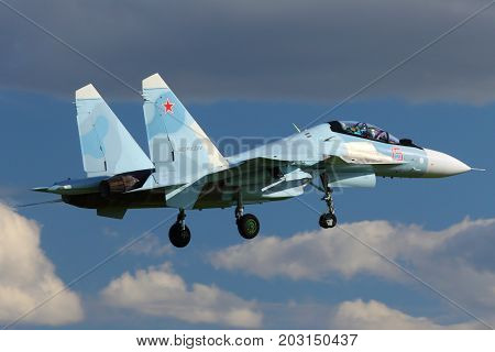 Kubinka, Moscow Region, Russia - June 9, 2015: Sukhoi SU-30SM 15 RED jet fighter of russian air force landing at Kubinka air force base during Army-2015 forum