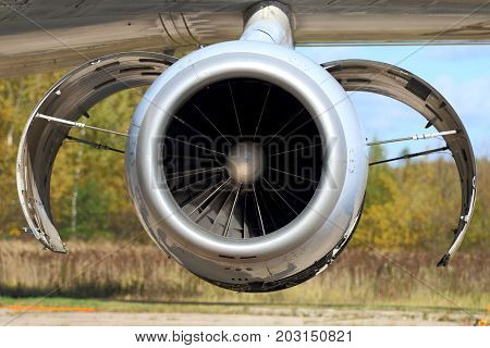 Jet airplane or aircraft engine with opened covers.