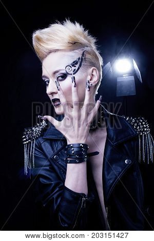 Fashion Rocker Style Model Girl Portrait. Hairstyle. Rocker or Punk Woman Makeup, Hairdo and black Nails. Smoky Eyes in studio, creative manicure