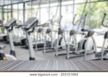 fitness facility center gym interior health club with sports training equipment for aerobic exercise workout and bodybuilding blurry defocused background