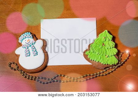 Greeting card with gingerbread cookies. Top view.