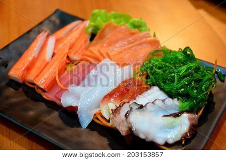 Sashimi set including crab stick tuna salmon and salmon belly the Japanese food note select focus with shallow depth of field