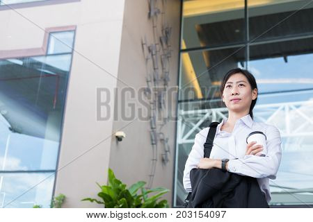 Businesswoman Holding Coffee Outside Office Building. Beautiful Young Asian Woman With Tea Go To Wor