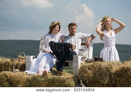 Man And Happy Girl Sitting On Bench On Mountain Landscape