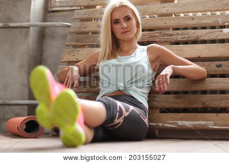 Sport and exercise. Beautiful woman in gym