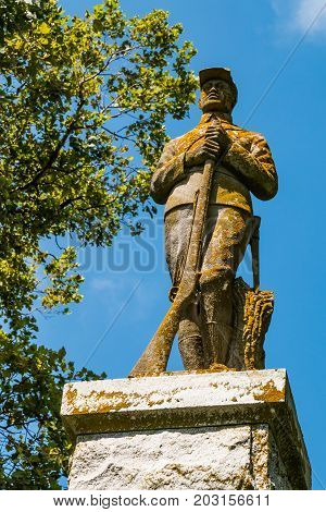 NORFOLK, VIRGINIA - JULY 9, 2017:  The statue of Sgt. William H. Carney atop a monument near about 100 black Civil War and Spanish-American War veterans buried in West Point Cemetery.