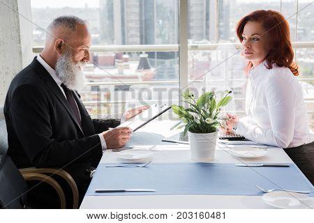 Mature Business People Having Meeting