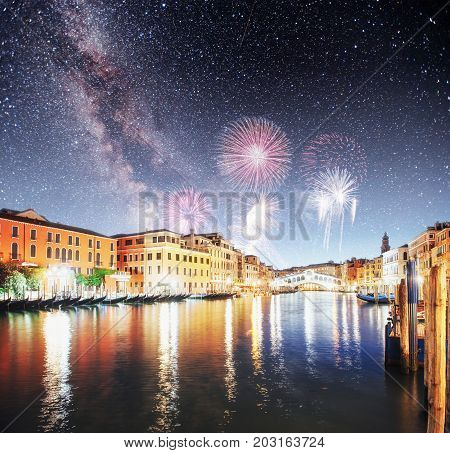 Beautiful calm night view of Amsterdam city. Colorful fireworks on the black sky background. Photo greeting card. Bokeh light effect, soft filter.