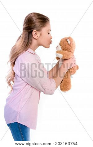 Little Girl Kissing Teddy Bear