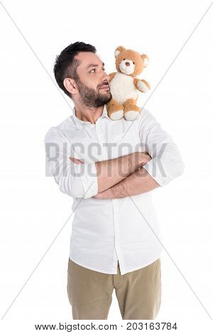 Man Carrying Teddy Bear On Shoulder