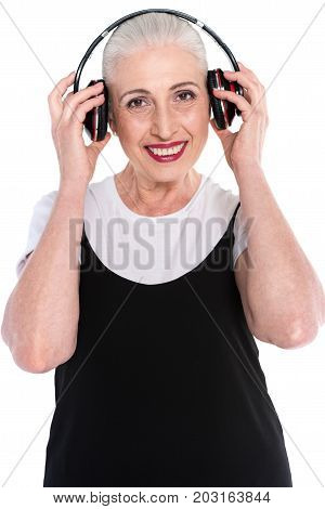 Senior Woman In Big Headphones