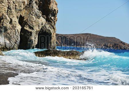 foam waves splash at stones on shore sea