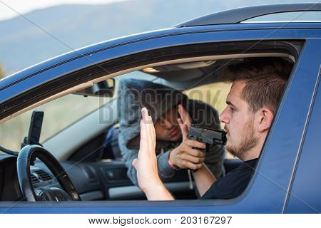 A Thief, A Criminal With A Pistol Threat, Tries To Steal A Car, Sits At The Passenger's Seat And Hol