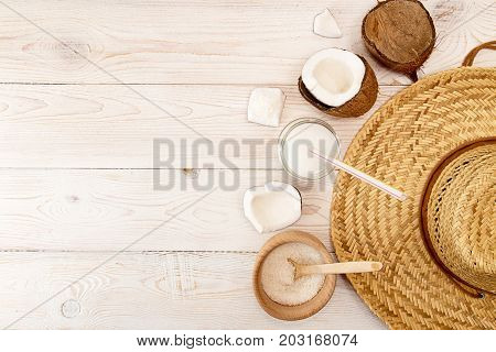Cowboy Hat, Half Of Coconut, Pieces Of Coconut, Coconut Flakes, Glass Jar With Coconut Milk On White
