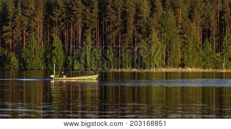 VARKAUS, FINLAND ON JULY 02. View of the surrounding by a lake where boat, people and tourists meet on July 02, 2017 in Varkaus, Finland. Unidentified people, boats. Editorial use.