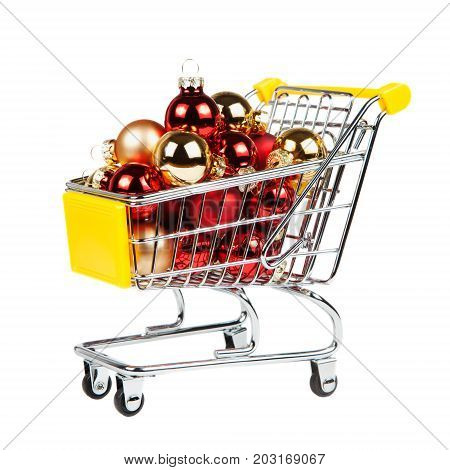 Christmas Balls In The Shopping Cart Isolated On White