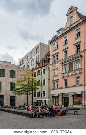 Munich, Germany - August 3, 2017: Scenic view of street in historical city centre of Munich a cloudy day of summer. Sankt-Jakobs-Platz.