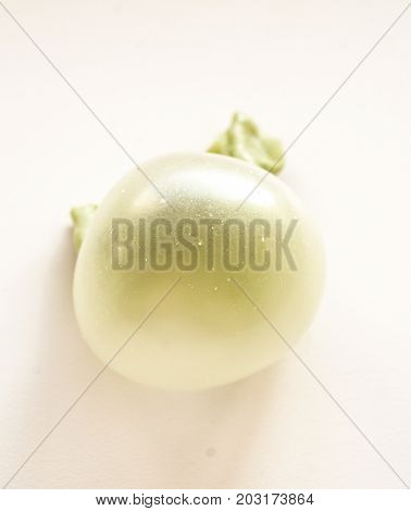 green chewing gum bubble isolated on white background close up
