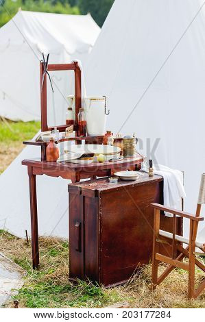 Old fashioned barber portable set - mirror rowan tincture razor shaving brush jar with water nippers for moustaches oil and ointments. Historical reconstruction of 19th century.