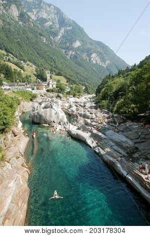 Lavertezzo Switzerland: 11 July 2002: Tourists swimming on the river at Lavertezzo on Verzasca valley on the italian part of Switzerland