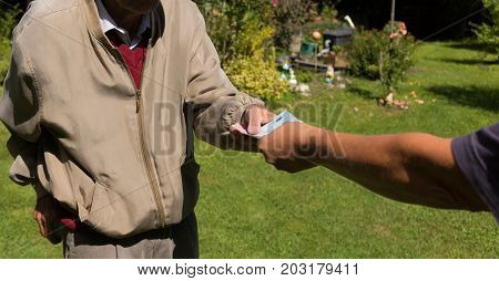 Senior Man's Hands Holding Euro Banknote. Struggling Pensioners Concept.