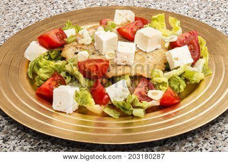 potato pancake mediterranean style with fresh tomato salad and goat cheese