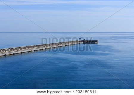 The Seawall in Malaga Spain out to the blue sea and sky