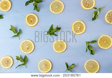 Flat Lay Still Life With Mint And Lemon On Blue Background. Pop Art Trend Still Life.