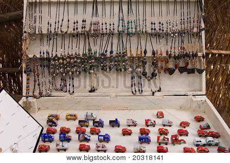 Toy cars and jewellery on market in Africa