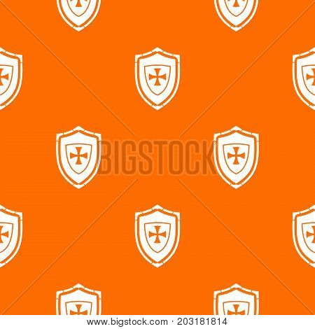 Shield with cross pattern repeat seamless in orange color for any design. Vector geometric illustration