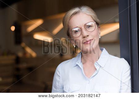 Pensive Woman In Eyeglasses