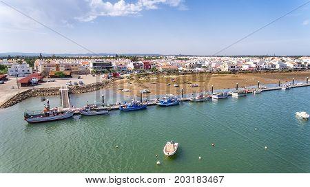 Aerial. Pier fishing boats in the village Cabanas de Tavira. Portugal