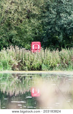 Life ring buoy at a lake for saving life in dangerous water