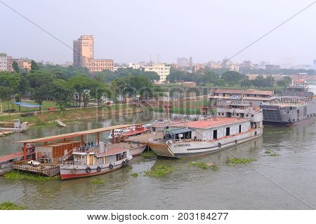 Dhaka, bangladesh, august 2017-A vessel filled with passengers returning home after holiday crossing the borigonga river near the Amin Bazar Bridge in dhaka in bangladesh taken on 7 september 2017.