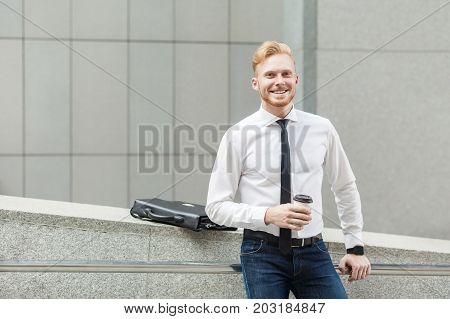 Happiness Business Man Holding Cup, Looking At Camera And Toothy Smile.