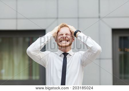 Headache. Businessman Touching Head And Have A Migraine.