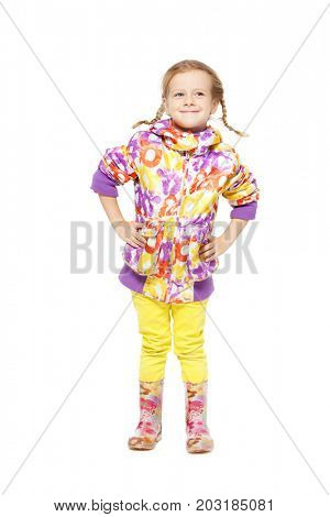 Child in autumn clothes and rubber boots. Child in gumboots