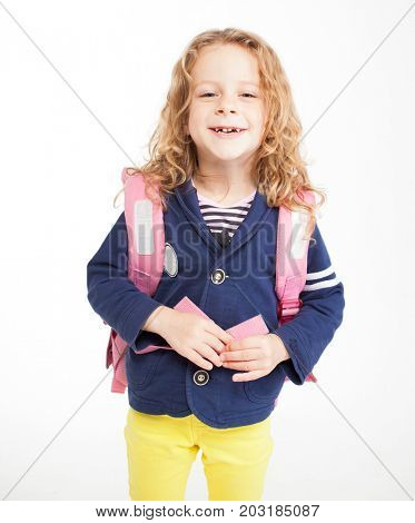 Little child with schoolbag. Happy child on white
