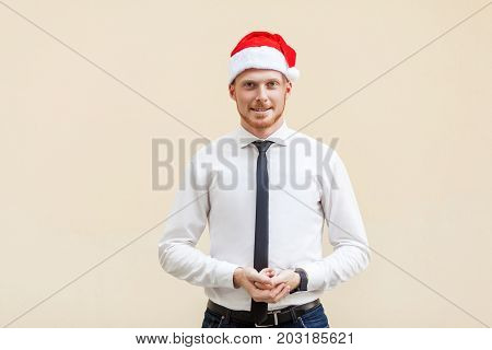 Young Adult Success Ginger Businessman Looking At Camera And Smiling.