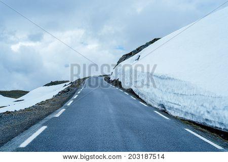 Norwegian Tourist Route Aurlandsfjellet runs from Aurlandsvangen to Laerdalsoyri. Snowy road Bjorgavegen