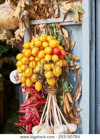Piennolo tomatoes bunch in a greengrocer stall. Pomodorino del Piennolo del Vesuvio. Neapolitan organic tomato.